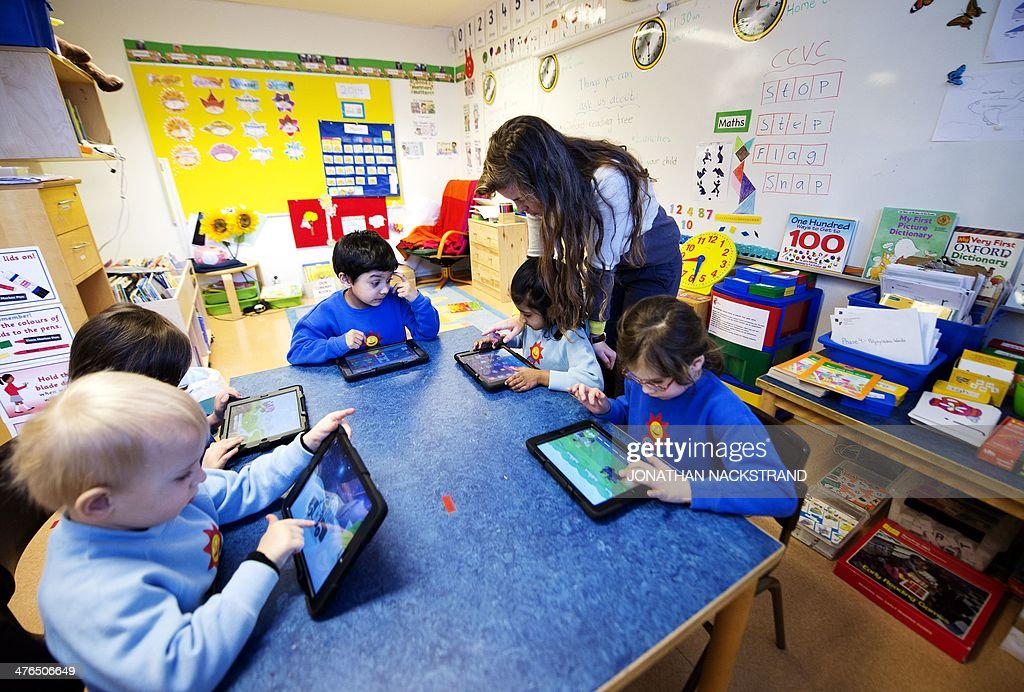 Nursery school pupils work with iPads on March 3, 2014 in Stockholm.