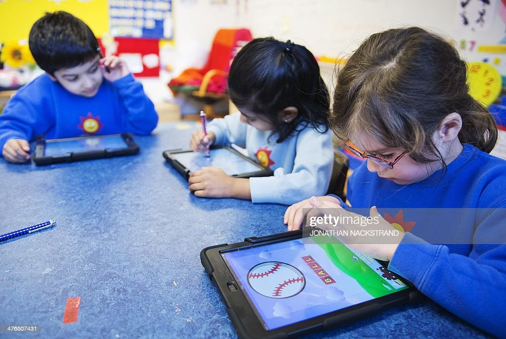 Nursery school pupils work with iPads on March 3, 2014 in Stockholm. AFP PHOTO/JONATHAN NACKSTRAND
