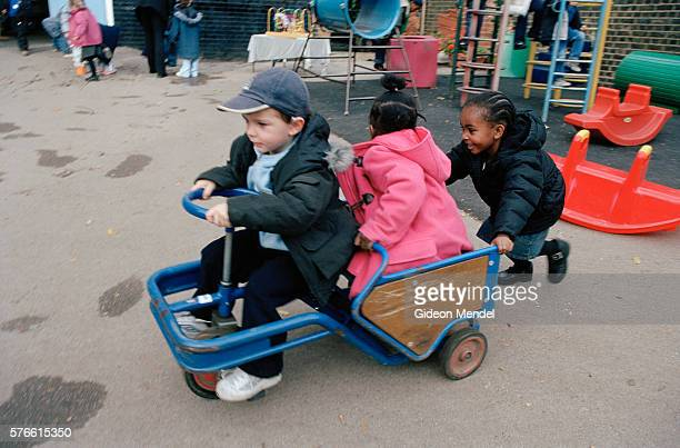 Nursery School Students Playing in Toy Car