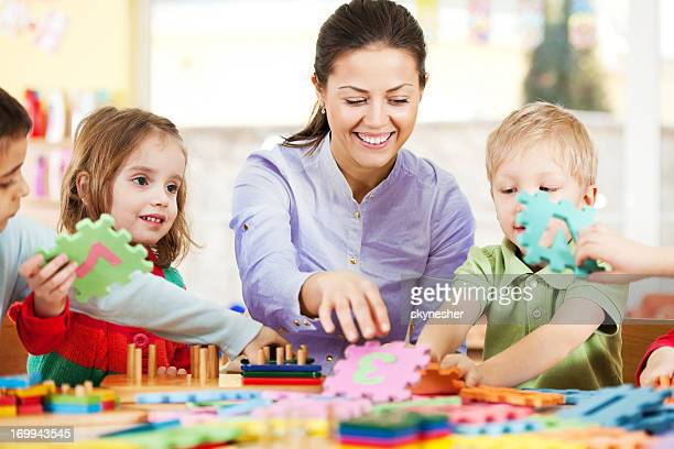 Nursery teacher playing with the kids.
