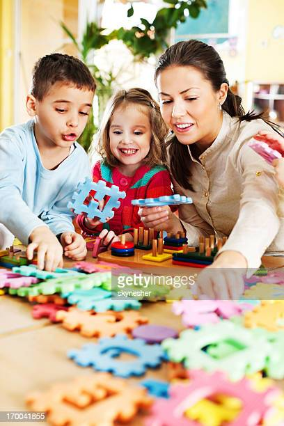 Nursery teacher playing with the kids.