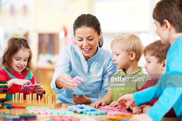 Nursery teacher playing with the kids