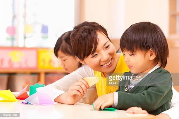 Nursery Teacher Talking to Children