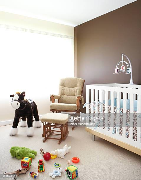 Nursery with crib, nursing chair and toys