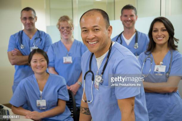 Nurses and doctors smiling together in hospital