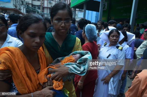 Nurses and trainee nurses rescue the mothers and babies to the safe place in Calcutta Medical College Major fire breaks at the Calcutta National...