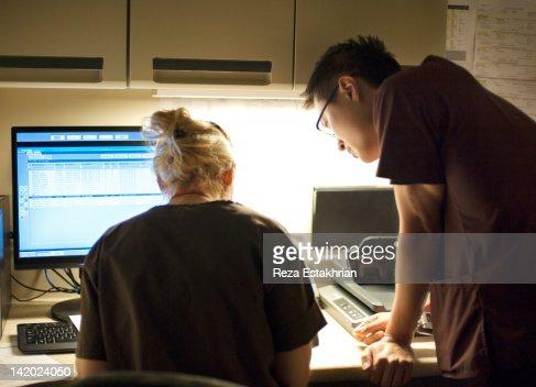 Nurses check written information : Stock Photo