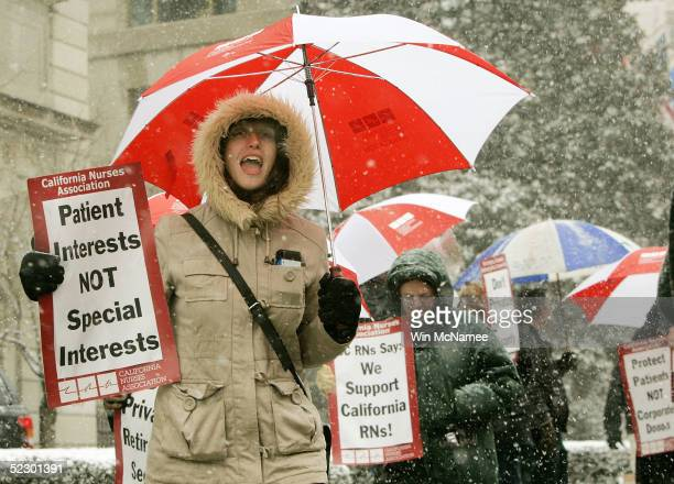 Nurses from California protest the appearance of California Governor Arnold Schwarzenegger outside the St Regis Hotel March 8 2005 in Washington DC...