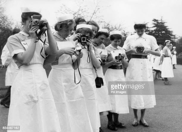 Nurses from King Edward VII Hospital in Windsor prepare their cameras for the visit by Queen Elizabeth II