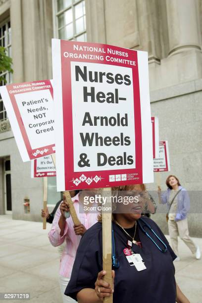 Nurses protest a visit by California Governor Arnold Schwarzenegger at a Republican fundraiser May 23 2005 in Chicago Illinois The nurses...