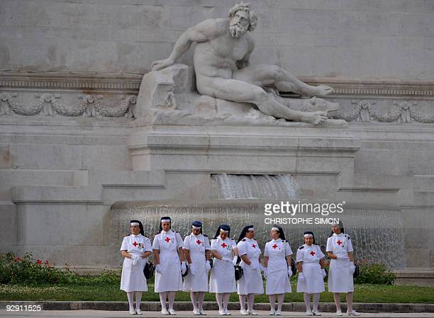 Nurses wait to watch a parade during celebrations on June 2 2009 marking the country's Republic Day Italian armed forces celebrate the 63rd...