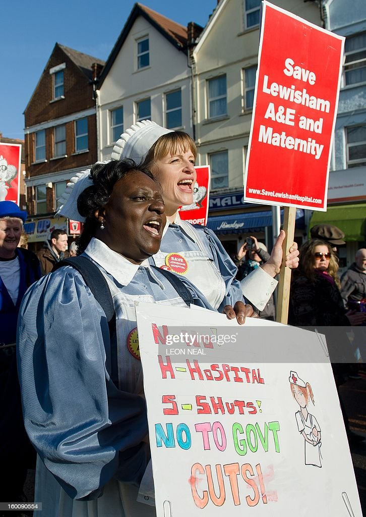 Nurses who took part in the London 2012 Olympic opening ceremony wear their costumes as they join demonstrators in South-East London on January 26, 2013 to protest against the proposed closure of the Accident and Emergency (A&E) and maternity units at Lewisham hospital. A Government-appointed administrator has recommended that the units be shut down to help tackle the financial crisis at the nearby South London Healthcare NHS Trust. Those protesting argue that leaving a single A&E unit for up to 750,000 people is 'ludicrous and highly dangerous'. AFP PHOTO/Leon Neal
