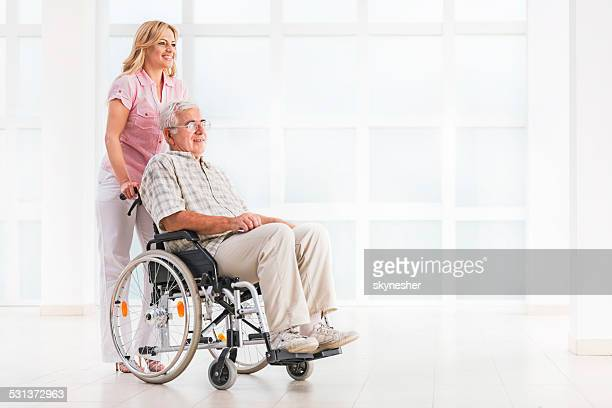 Nursing assistant and senior man.