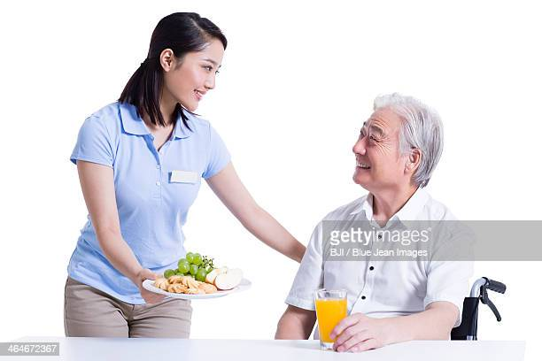 Seniors information service stock photos and pictures for Assistant cuisine