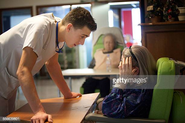 Nursing Home Residents State nursing home in HauteSavoie France A nurse chats to a resident