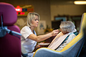 Nursing Home Residents State nursing home in HauteSavoie France An auxiliary nurse helps a resident at meal time