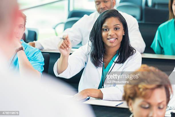 Nursing or medical student asking question during healthcare conference