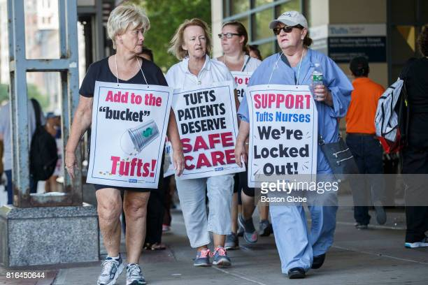 Nursing staff and supporters walk a picket line in front of Tufts Medical Center in Boston July 16 2017 The nurses were locked out by the hospital...