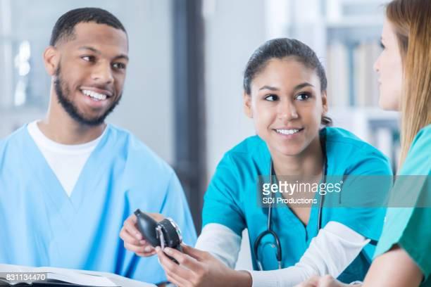 Nursing students use blood pressure gauge