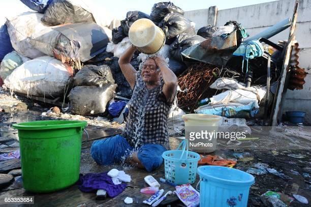 Nurtinah baths after work as a scavenger Nurtinah a farm worker from Pucang Anom village Cerme subdistrict Bondowoso district East Java Province...