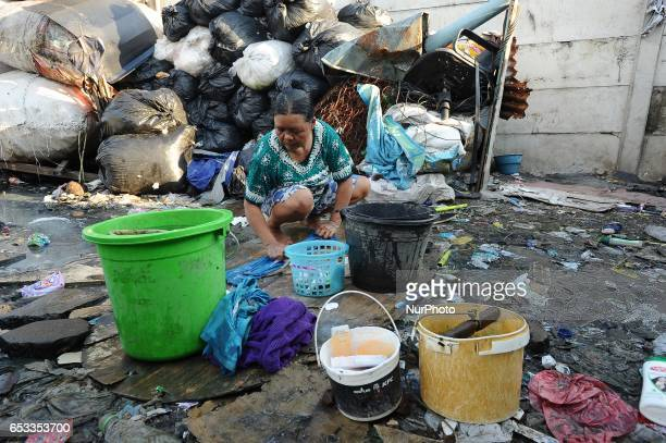 Nurtinah washes her clothes after work as a scavenger Nurtinah a farm worker from Pucang Anom village Cerme subdistrict Bondowoso district East Java...