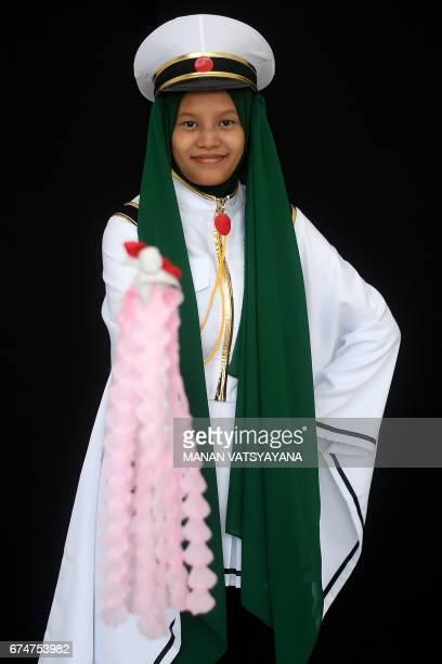 Nurul Shafiqah a young Malaysian Muslim cosplayer dressed as 'Hatsune Miku' poses during the 'Hijab Cosplay' event in Subang Jaya outside of Kuala...