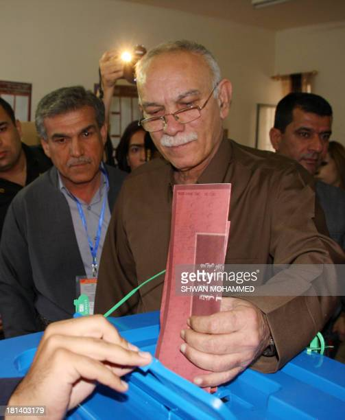 Nusherwan Mustafa Iraqi Kurdish leader of the Movement for Change casts his ballot during the Kurdistan's legislative election at a polling station...