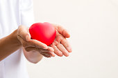 Nusre holding red heart in 2 hands; healthcare concept; love heart for valentine