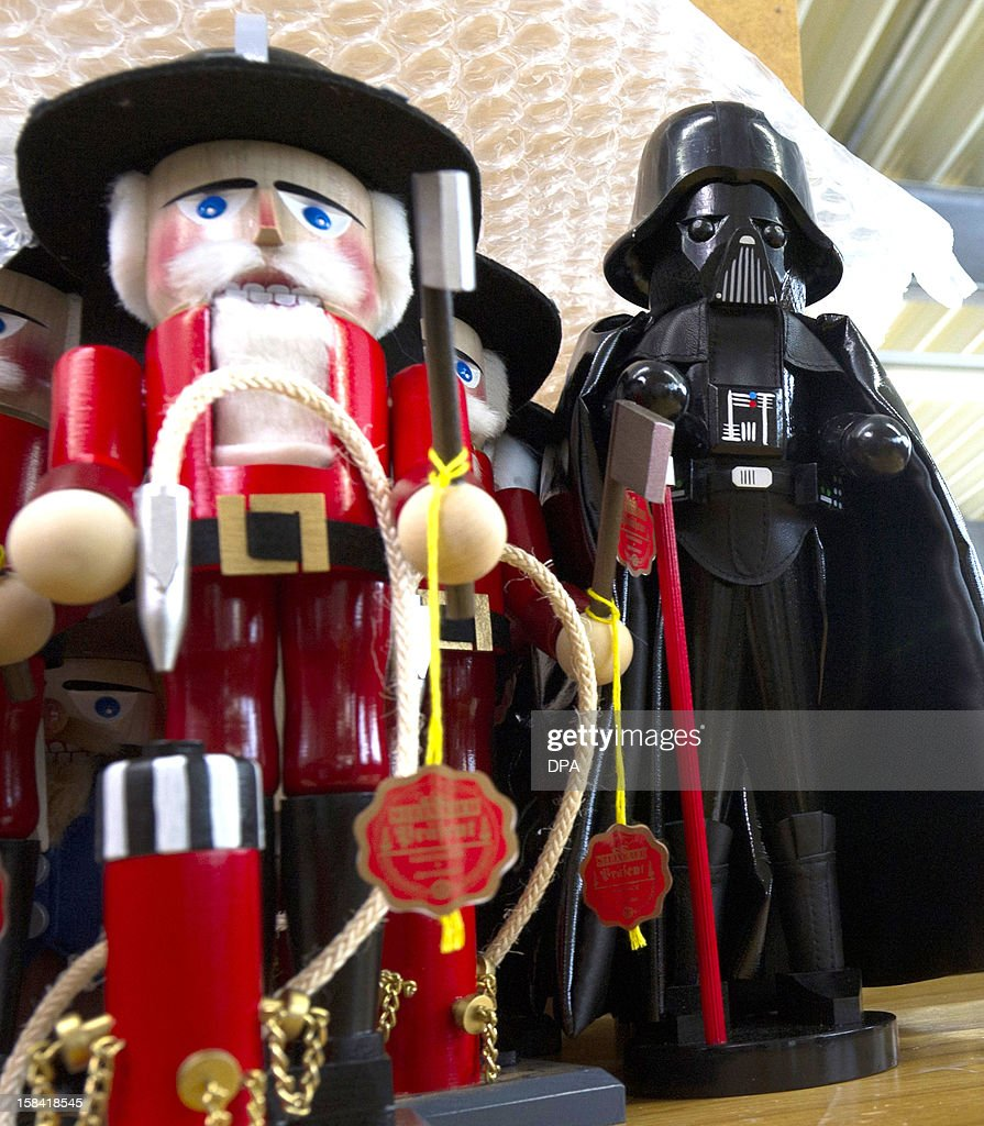 A nutcracker formed as Darth Vader stands next to a traditional nutcracker figure at a nutcracker manufacturer hall in Hohenhameln, northern Germany, on December 14, 2012. The company offers around 350 different kinds of nutcrackers. PHOTO / Emily Wabitsch GERMANY OUT