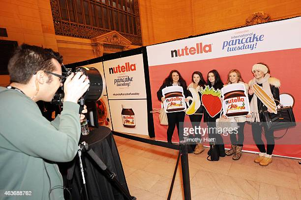 Nutella fans pose in front of customized photo both and share with friends via social media at Nutella's International Pancake Tuesday event on...