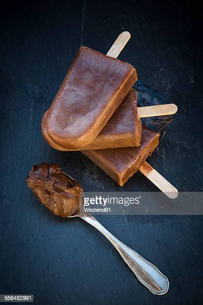 Nutella popsicle, spoon with Nutella on slate