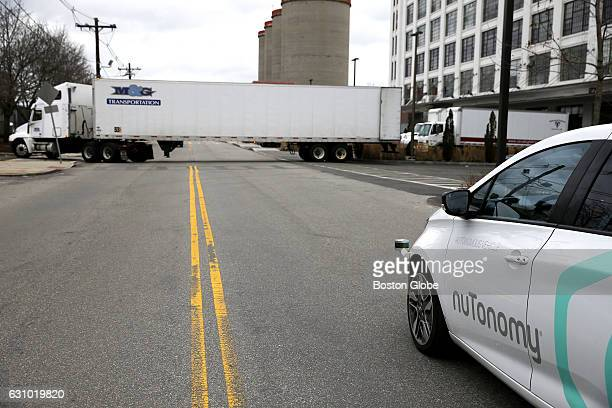NuTonomy's driverless car the first to launch in Boston pauses as a truck pulls out as it takes a spin around Drydock Ave in South Boston on Jan 4...