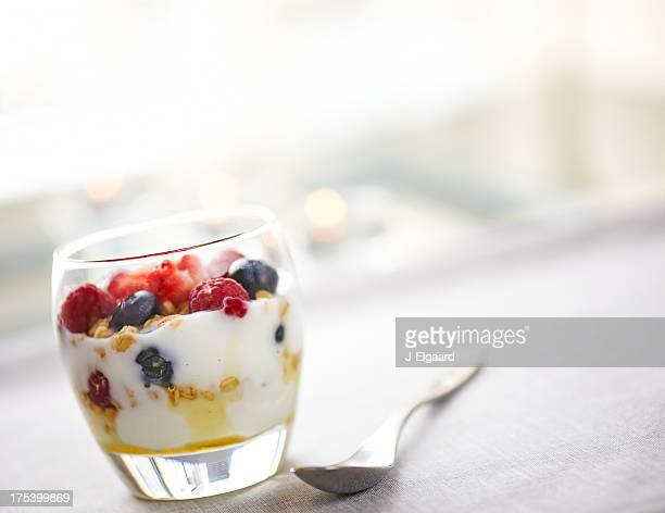 Nutritious glass of yougurt with honey and fruits