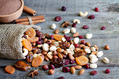 Nuts and dried fruits mixed on wooden boards
