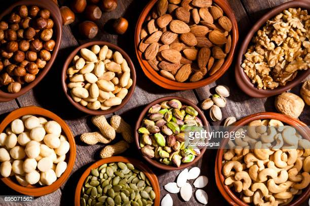 Nuts assortment on rustic wood table.