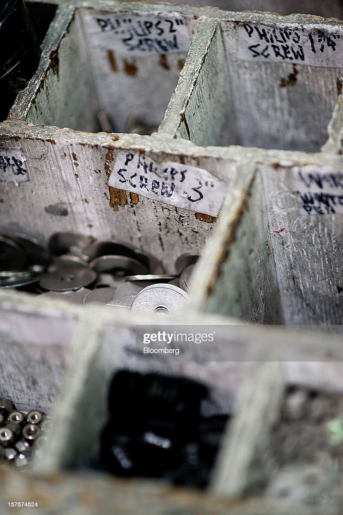 Nuts, bolts, and washers sit in compartments on the assembly line at the Nautic Global Group production facility in Elkhart, Indiana, U.S., on Tuesday, Dec 4, 2012. The U.S. Census Bureau is scheduled to release factory orders data on Dec. 5. Photographer: Ty Wright/Bloomberg via Getty Images