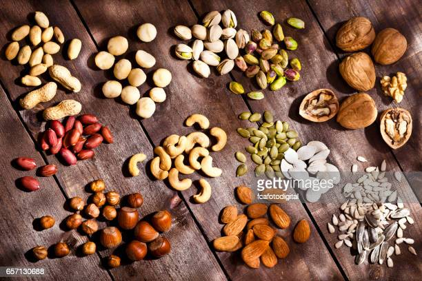 Nuts collection on rustic wood table
