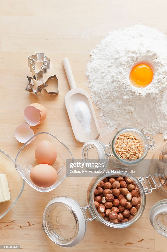 Nuts, eggs, flour and cookie cutters : Stock Photo