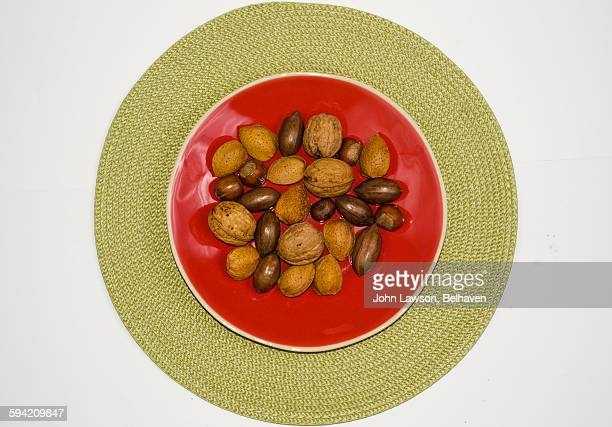 Nuts on a red plate