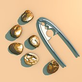 Nuts with shell and tool to split the nuts, split, seen from above. 3d rendering