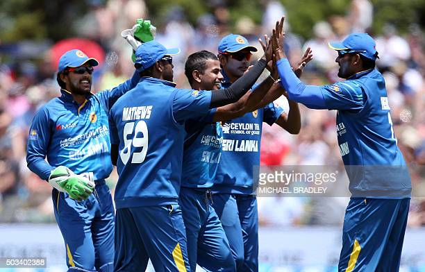 Nuwan Kulasekara and team mates celebrate the wicket of Martin Guptill of New Zealand during the fifth one day international cricket match between...