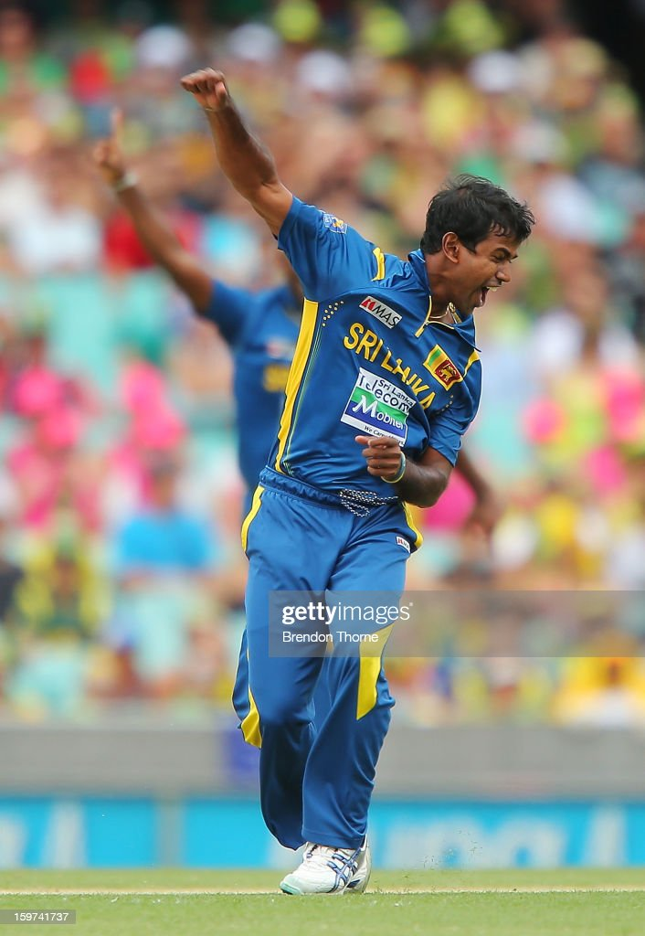 <a gi-track='captionPersonalityLinkClicked' href=/galleries/search?phrase=Nuwan+Kulasekara&family=editorial&specificpeople=608308 ng-click='$event.stopPropagation()'>Nuwan Kulasekara</a> of Sri Lanka celebrates after claiming the wicket of Phillip Hughes of Australia during game four of the Commonwealth Bank one day international series between Australia and Sri Lanka at Sydney Cricket Ground on January 20, 2013 in Sydney, Australia.
