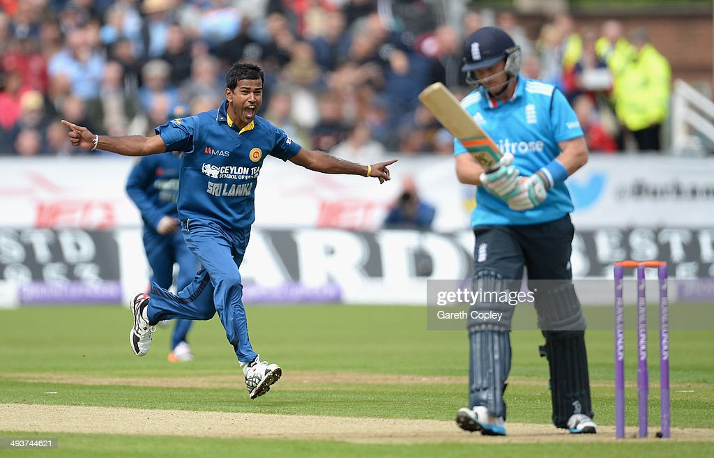 <a gi-track='captionPersonalityLinkClicked' href=/galleries/search?phrase=Nuwan+Kulasekara&family=editorial&specificpeople=608308 ng-click='$event.stopPropagation()'>Nuwan Kulasekara</a> of Sri Lanka celebrates dismissing Ian Bell of England during the 2nd Royal London One Day International match between England and Sri Lanka at The Riverside on May 25, 2014 in Chester-le-Street, England.
