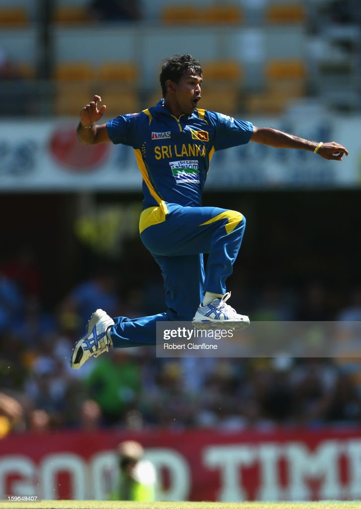 Nuwan Kulasekara of Sri Lanka celebrates taking the wicket of Michel Clarke of Australia during game three of the Commonwealth Bank One Day International Series between Australia and Sri Lanka at The Gabba on January 18, 2013 in Brisbane, Australia.