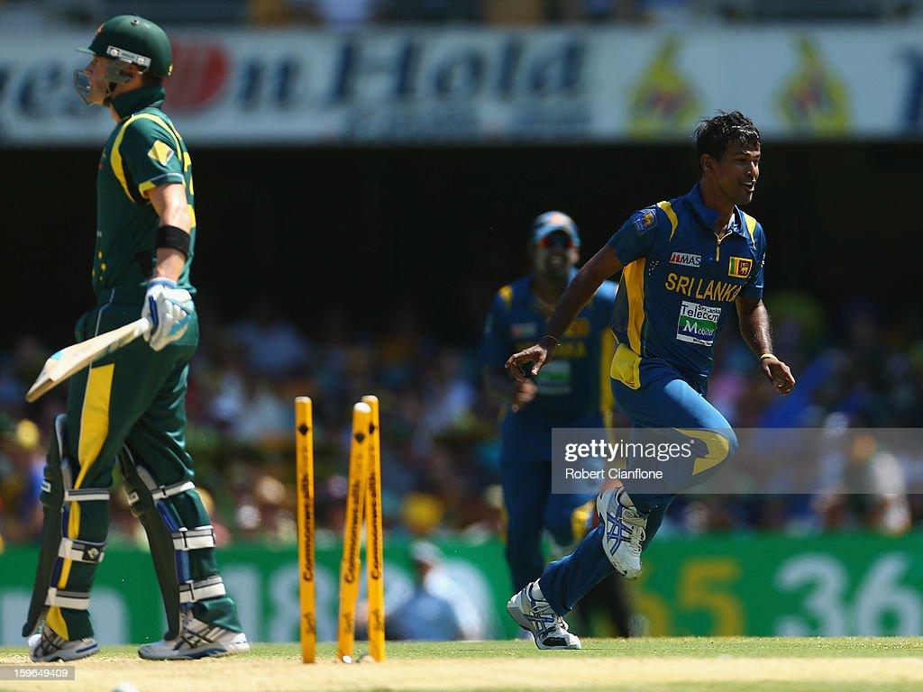 Nuwan Kulasekara of Sri Lanka celebrates taking the wicket of Michel Clarke of Australia during game three of the Commonwealth Bank One Day International Series between Australia and Sri Lanka at The Gabba on January 18, 2013 in Brisbane, Australia.