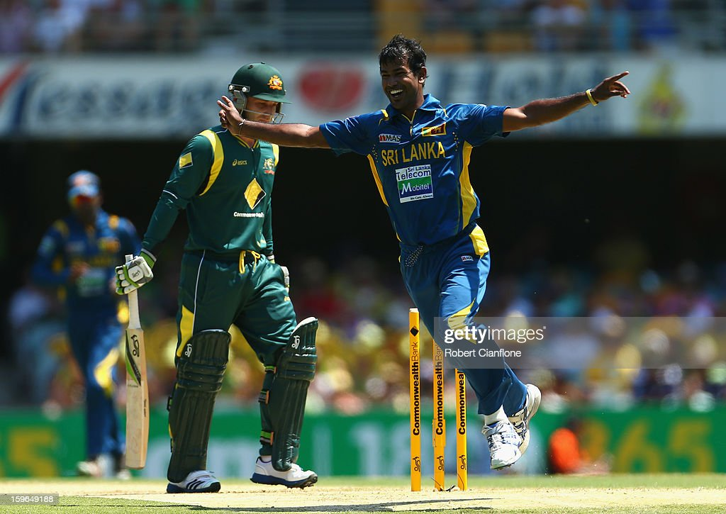 <a gi-track='captionPersonalityLinkClicked' href=/galleries/search?phrase=Nuwan+Kulasekara&family=editorial&specificpeople=608308 ng-click='$event.stopPropagation()'>Nuwan Kulasekara</a> of Sri Lanka celebrates taking the wicket of <a gi-track='captionPersonalityLinkClicked' href=/galleries/search?phrase=Phillip+Hughes+-+Cricketer&family=editorial&specificpeople=757530 ng-click='$event.stopPropagation()'>Phillip Hughes</a> of Australia during game three of the Commonwealth Bank One Day International Series between Australia and Sri Lanka at The Gabba on January 18, 2013 in Brisbane, Australia.