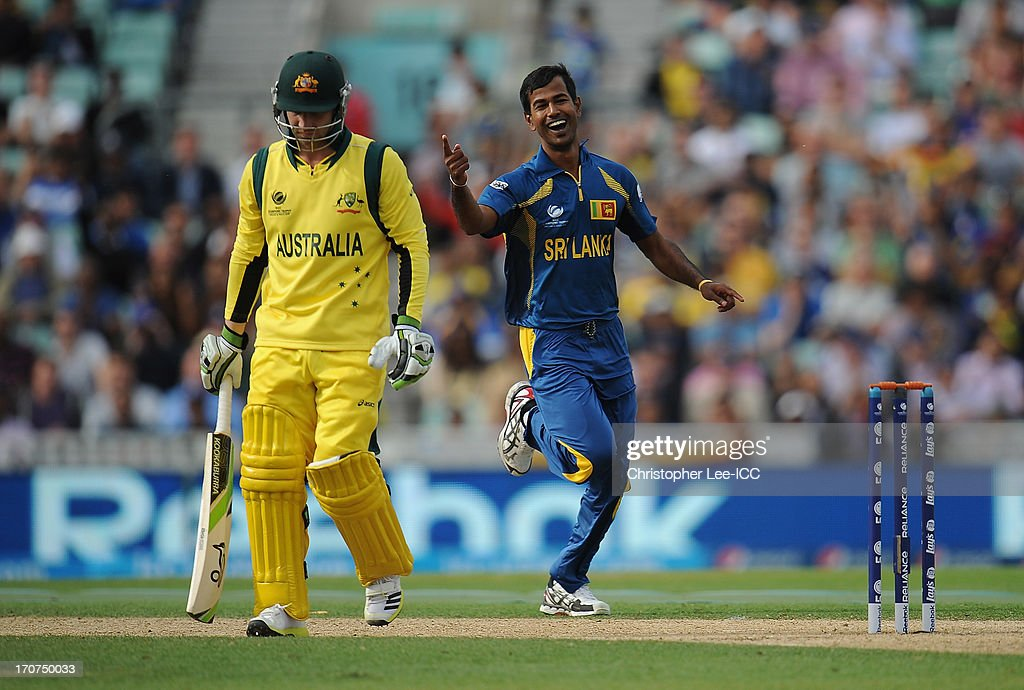 <a gi-track='captionPersonalityLinkClicked' href=/galleries/search?phrase=Nuwan+Kulasekara&family=editorial&specificpeople=608308 ng-click='$event.stopPropagation()'>Nuwan Kulasekara</a> of Sri Lanka celebrates taking the wicket of <a gi-track='captionPersonalityLinkClicked' href=/galleries/search?phrase=Phillip+Hughes+-+Cricketer&family=editorial&specificpeople=757530 ng-click='$event.stopPropagation()'>Phillip Hughes</a> of Australia during the ICC Champions Trophy Group A match between Sri Lanka and Australia at The Oval on June 17, 2013 in London, England.