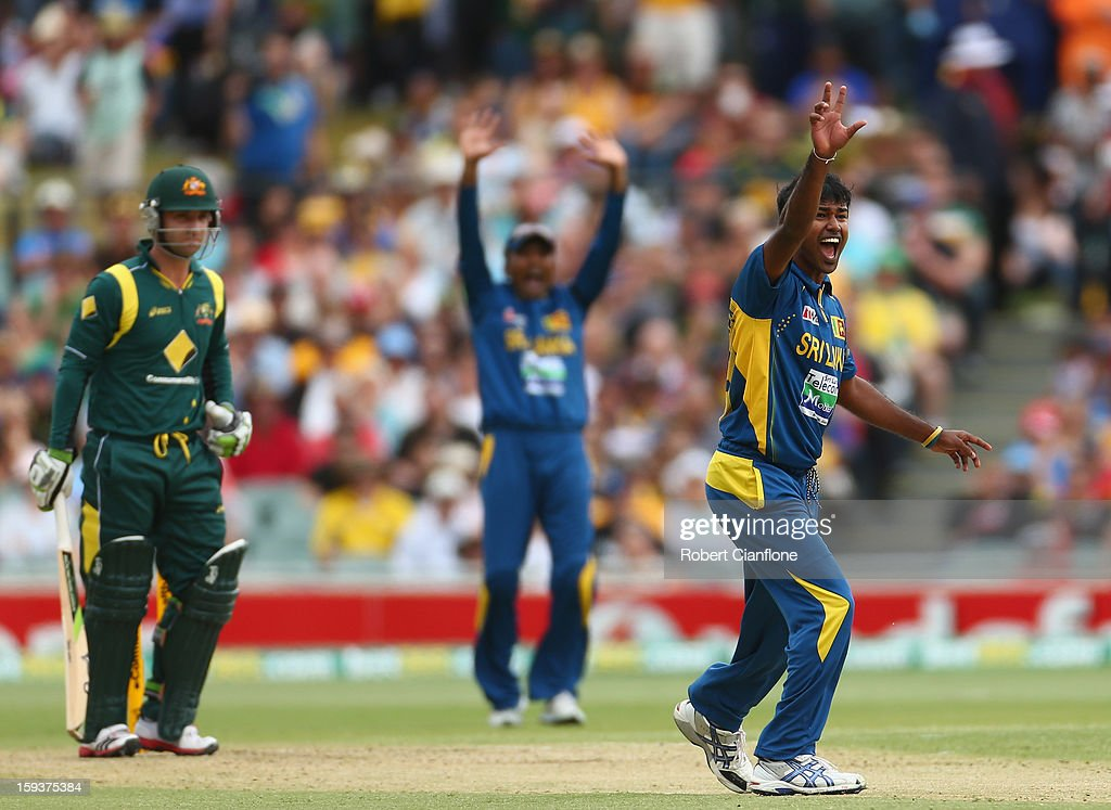 <a gi-track='captionPersonalityLinkClicked' href=/galleries/search?phrase=Nuwan+Kulasekara&family=editorial&specificpeople=608308 ng-click='$event.stopPropagation()'>Nuwan Kulasekara</a> of Sri Lanka takes the wicket of <a gi-track='captionPersonalityLinkClicked' href=/galleries/search?phrase=Phillip+Hughes+-+Cricketer&family=editorial&specificpeople=757530 ng-click='$event.stopPropagation()'>Phillip Hughes</a> of Australia during game two of the Commonwealth Bank One Day International series between Australia and Sri Lanka at Adelaide Oval on January 13, 2013 in Adelaide, Australia.