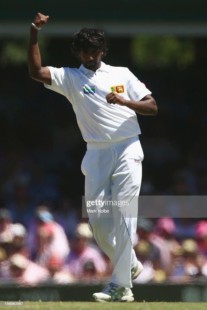 Nuwan Pradeep of Sri Lanka celebrates taking the wicket of Peter Siddle of Australia during day three of the Third Test match between Australia and Sri Lanka at Sydney Cricket Ground on January 5, 2013 in Sydney, Australia.