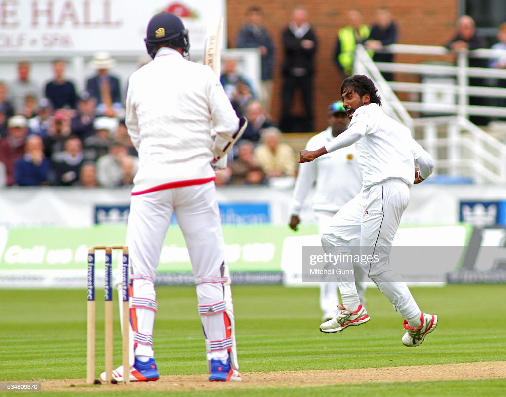 Nuwan Pradeep of Sri Lanka celebrates taking the wicket of <a gi-track='captionPersonalityLinkClicked' href=/galleries/search?phrase=Stuart+Broad&family=editorial&specificpeople=574360 ng-click='$event.stopPropagation()'>Stuart Broad</a> of England during day two of the 2nd Investec Test match between England and Sri Lanka at Emirates Durham ICG on May 28, 2016 in Chester-le-Street, United Kingdom.